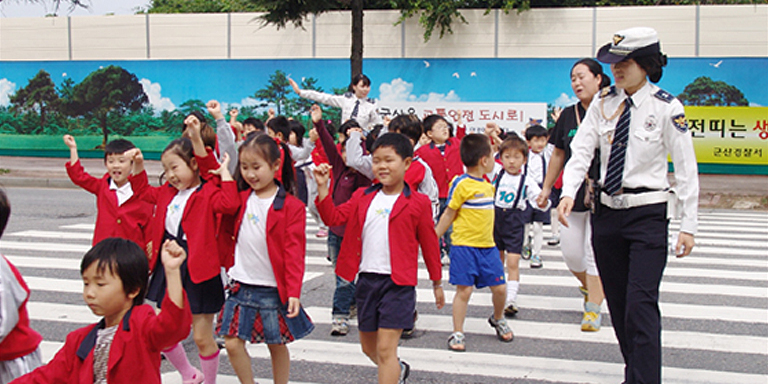 Children participate in a traffic safety campaign held in Gunsan City in the Republic of Korea. Photo credit: The Korea Transport Institute.