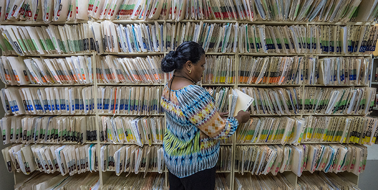Artificial intelligence and machine learning can make sorting through voluminous documents easier and faster by automatically identifying and classifying records. Photo credit: ADB.