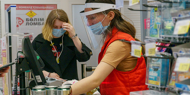 Use of medical masks and avoiding direct physical contact with other persons can prevent COVID-19 transmission in the workplace. Photo credit: ADB.