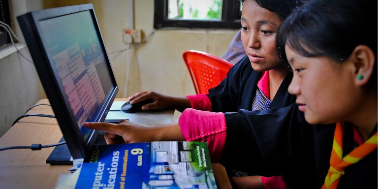 Students learn computer skills at a community e-center in Bhutan. Photo credit: ADB.