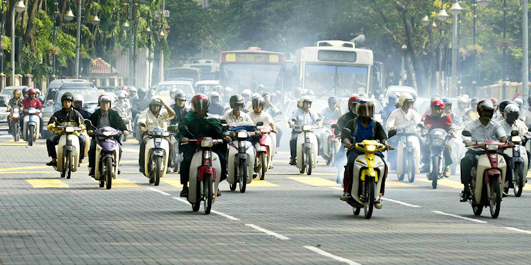 Motorcycle traffic in Kuala Lumpur, Malaysia. App-based motorcycle taxi services are one aspect of Southeast Asia's digital transformation. Photo credit: ADB.