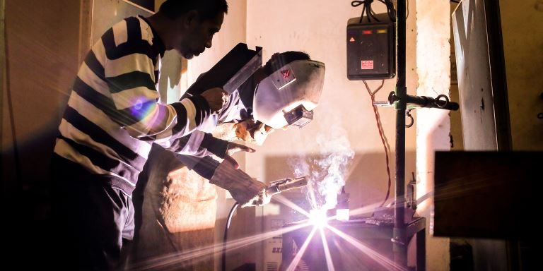 An instructor guiding a trainee welder attending a short training under the Skills Development Project in Bangladesh. The Project aims to help reduce unemployment rates in Bangladesh. Photo credit: ADB.