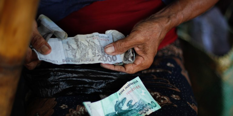 A study of four countries in Southeast Asia (Cambodia, Indonesia, Myanmar and the Philippines) shows only 18% of adults use a bank account to receive wages or pay utility bills. Photo credit: ADB.
