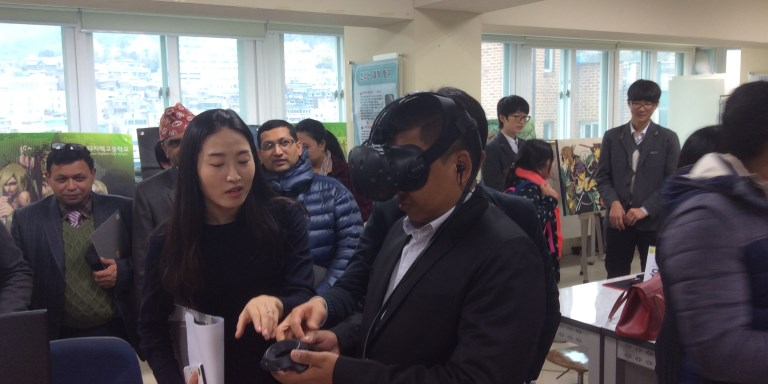 A visitor to Seoul Digitech High School tries on a virtual reality headset. The Republic of Korea has a highly developed and integrated ICT system in its education sector. Photo credit: ADB.