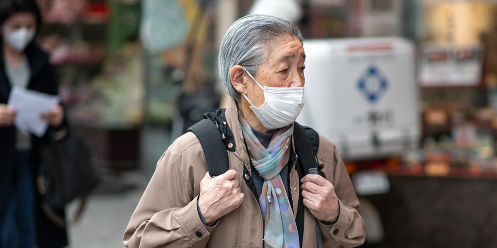An older woman crosses a street at Tokyo's Shibuya. Photo credit: Asian Development Bank.