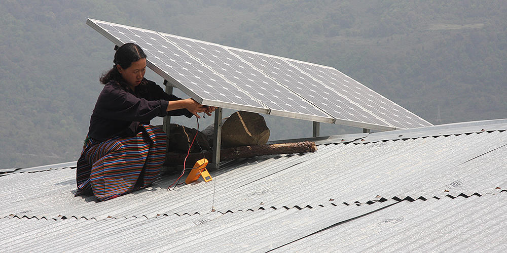 A solar panel is installed on a roof in Bhutan. The South Asian country is the first to become carbon negative in the world. Photo credit: Asian Development Bank.