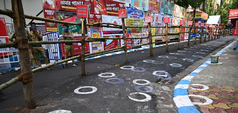 White circles were drawn on a road in India to enforce social distancing. Photo credit: iStock/Abhishek Kumar Sah.
