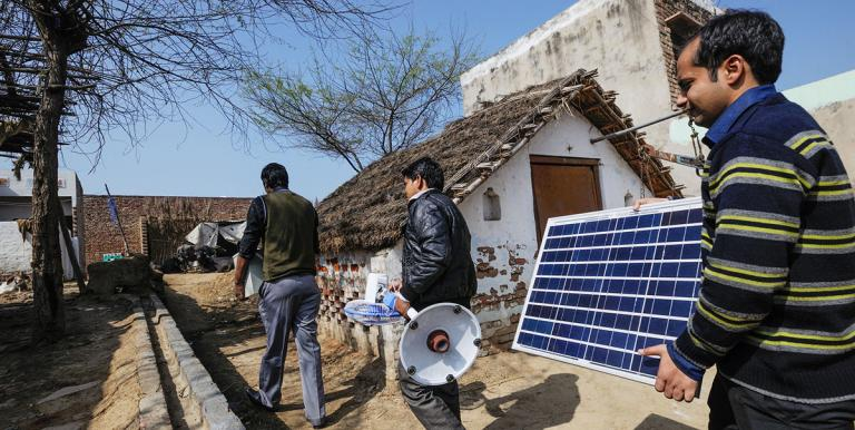 Sales agents visit a remote village in India to demonstrate their off-grid solar system. Improving access to clean energy needs the support of businesses and consumers. Photo credit: Asian Development Bank.