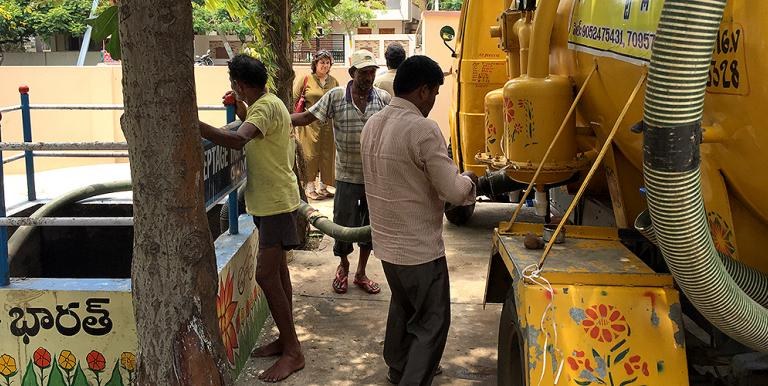 Emptying a vacuum tanker at a sewer discharge point in Visakhapatnam, India. Photo credit: Water & Sanitation for the Urban Poor.