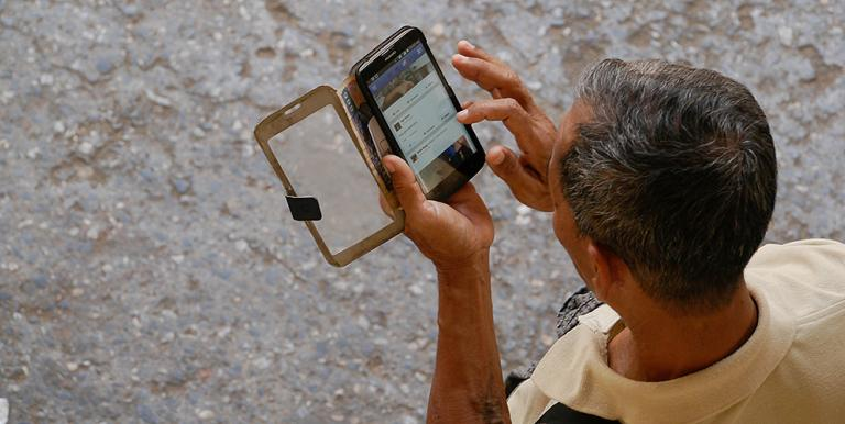 Mobile phones and the internet are two methods typically used to access one's financial account. Photo credit: ADB.