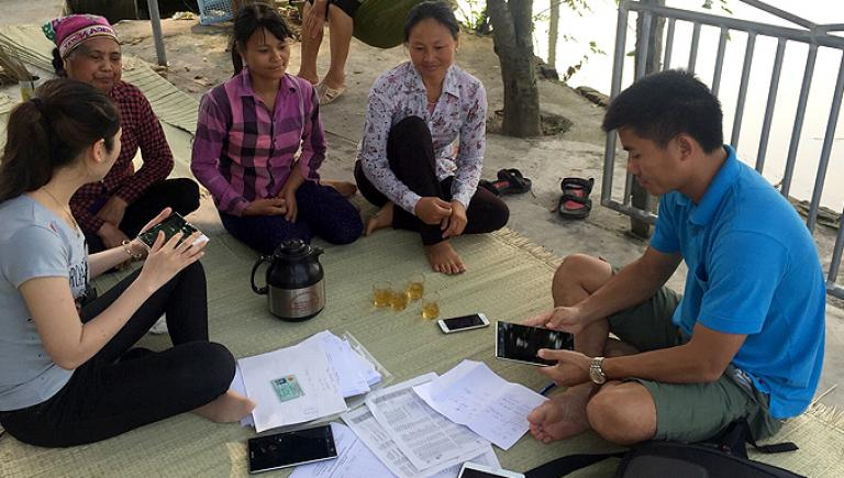 Staff from the Ministry of Agricultural and Rural Development in Viet Nam conduct a survey among farmers using smartphones. Photo credit: ADB.