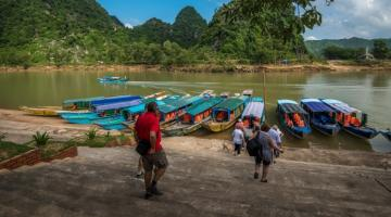 Blue boats transporting tourists going to Phong Nha, Viet Nam. The wharf was funded by ADB's Greater Mekong Subregion Sustainable Tourism Development Project, giving local people more work opportunities. Photo Credit: ADB.