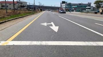 Paved with fiber-reinforced asphalt mixture, the Republic of Korea's Highway 38 is in satisfactory state after 4.5 years of operation. Photo credit: KICT.