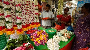A roadside flower vendor does business at Singapore's Little India district. Traditional occupations like these remain part of daily life in Singapore.  Photo credit: ADB