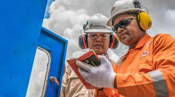 Workers record data at a project site. Photo credit: Gerard Joren/ADB.