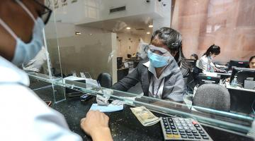 The COVID-19 pandemic has disrupted cash flows, including payments, investments, and remittances. Photo credit: ADB.
