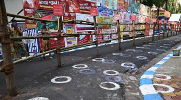 White circles were drawn on a road in India to enforce social distancing. Photo credit: iStock/Abhishek Kumar Sah.