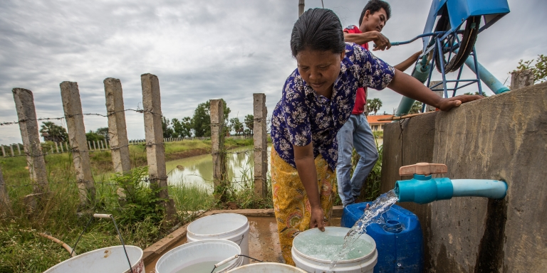 A Cambodian farmer at an ADB-supported community well in Banteay Meanchey province.
