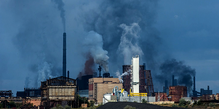 Smoke rises from a factory in developing Asia. Photo credit: ADB.